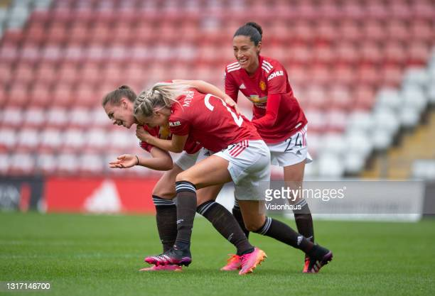 Kirsty Hanson of Manchester United celebrates scoring their team's second goal with team mates Millie Turner and Christen Press during the Barclays...