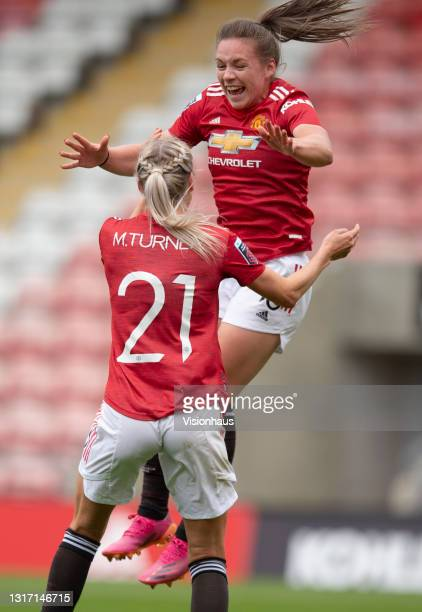 Kirsty Hanson of Manchester United celebrates scoring their team's second goal with team mate Millie Turner during the Barclays FA Women's Super...