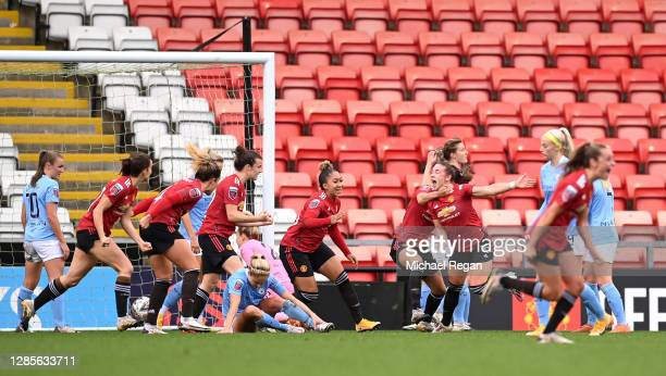 Kirsty Hanson of Manchester United celebrates with her team mates after scoring her team's second goal during the Barclays FA Women's Super League...