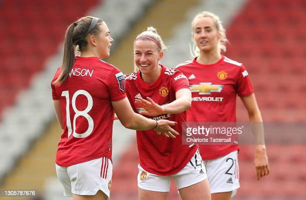 Kirsty Hanson of Manchester United celebrates with team mate Jackie Groenen after scoring their side's first goal during the Barclays FA Women's...
