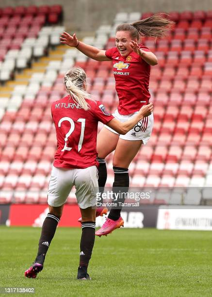 Kirsty Hanson of Manchester United celebrates with team mate Millie Turner after scoring her team's second goal during the Barclays FA Women's Super...