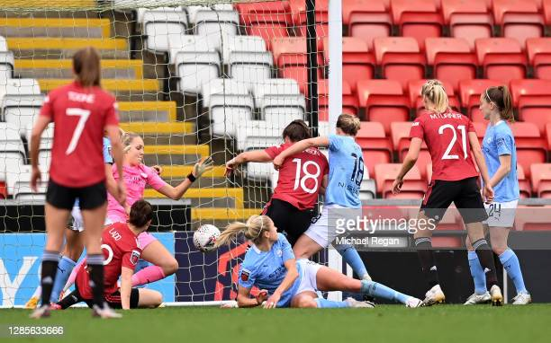 Kirsty Hanson of Manchester United scores her team's second goal during the Barclays FA Women's Super League match between Manchester United Women...