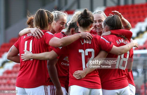 Kirsty Hanson of Manchester United Women celebrates with her team mates after scoring her sides first goal during the Barclays FA Women's Super...