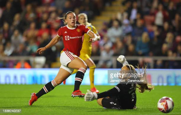 Kirsty Hanson of Manchester United Women scores the opening goal during the Barclays FA Women's Super League match between Manchester United Women...