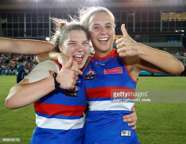 Kirsty Lamb and Bailey Hunt of the Bulldogs celebrate after making it through to the grand final during the 2018 AFLW Round 07 match between the...