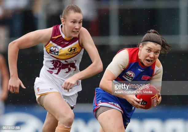 Kirsty Lamb of the Bulldogs in action ahead of Tahlia Randall of the Lions during the 2018 AFLW Grand Final match between the Western Bulldogs and...