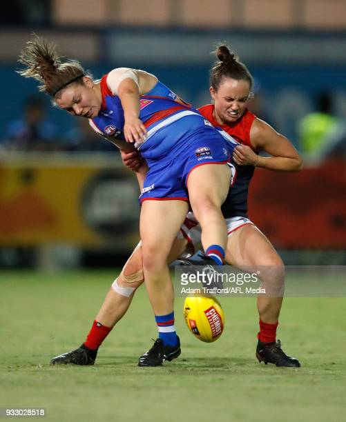 Kirsty Lamb of the Bulldogs is tackled by Daisy Pearce of the Demons during the 2018 AFLW Round 07 match between the Western Bulldogs and the...