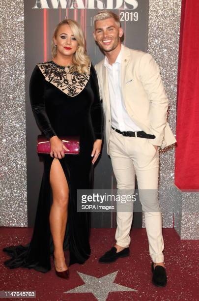 Kirsty Leigh Porter and Kieron Richardson arrive on the red carpet during The British Soap Awards 2019 at The Lowry, Media City, Salford in...