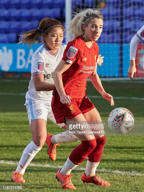 Kirsty Linnett of Liverpool FC Women and Cho SoHyun of West Han United Women in action during the Barclays FA Women's Super League match between...