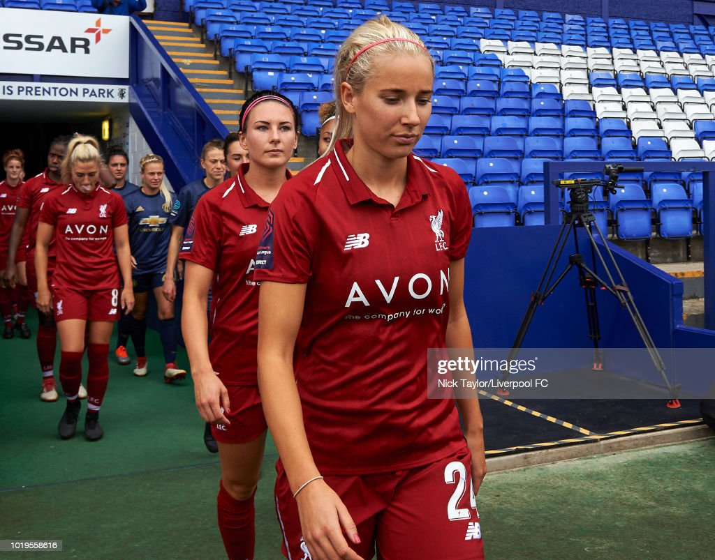 Kirsty Linnett walks on to the pitch at the start of the Liverpool