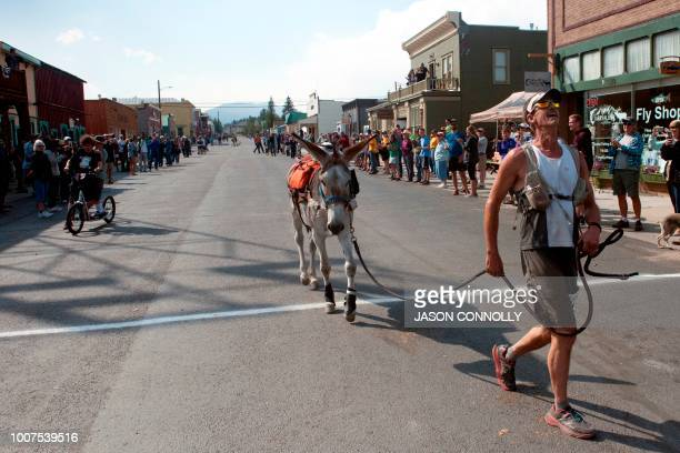 Kirt Courkamp of Pine Colorado raises his head in exhaustion after winning the Pack Burro Race during the 70th Annual Burro Days in Fairplay Colorado...
