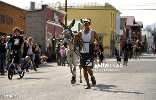 Kirt Courkamp of Pine right smiles with joy as he and his donkey Mary Margaret win the29 mile race in the 70th annual World Championship Pack Burro...
