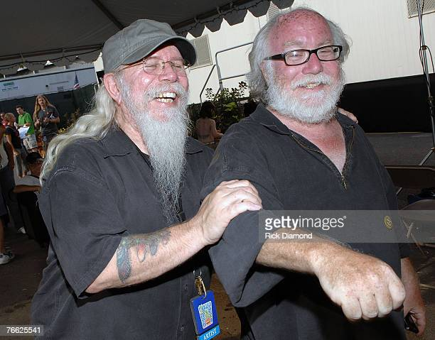 Kirt West Allman Brothers Tour Mananger and Photographer Paul Natkjin Backstage at Farm Aid 2007 at ICAHN Stadium on Randall's Island NY September...