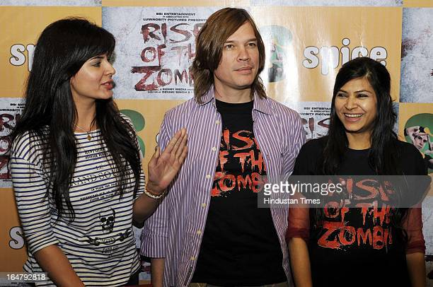 Kirti Kulhari Luke Kenny Devaki Singh pose for the photographs before attending a press conference for their upcoming film Rise of the Zombies at...