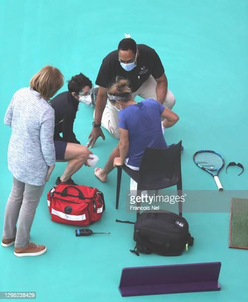 Kirtsen Flipkens of Belguim receives medical attention during her Women's Singles match on Day Three of the Abu Dhabi WTA Women's Tennis Open at...