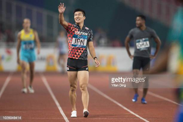 Kiryu Yoshihide of Japan waves to supporters during Athletics MenÕs 4x100m Relay Round 1 at GBK Main Stadium on day eleven of the Asian Games on...