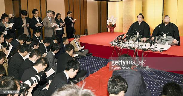 Kisenosato alongside his stablemaster Tagonoura attends a press conference at a Tokyo hotel on Jan 25 after the Japan Sumo Association finalized his...