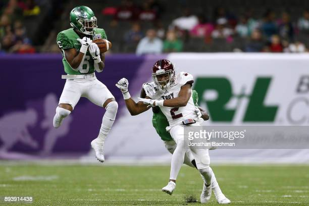Kishawn McClain of the North Texas Mean Green intercepts a pass intended for John Johnson of the Troy Trojans in the first half during the RL...