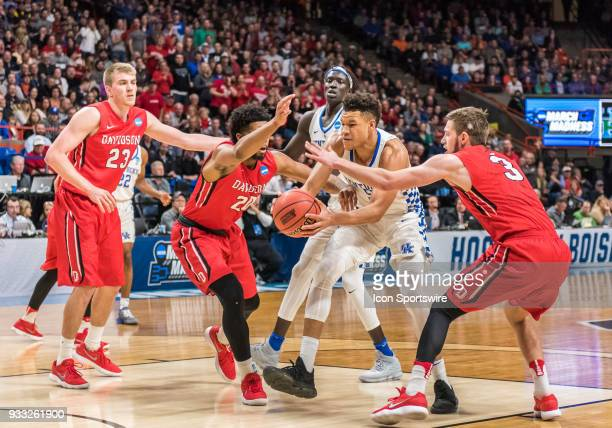 KiShawn Pritchett of the Davidson Wildcats and G Jordan Watkins of the Davidson Wildcats reach in tandem for a steal on F Kevin Knox of the Kentucky...
