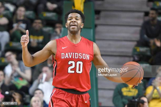 KiShawn Pritchett of the Davidson Wildcats dribbles the ball during a college basketball game against the George Mason Patriots at the Eagle Bank...
