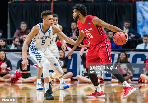 KiShawn Pritchett of the Davidson Wildcats moves around the back of the arch with F Kevin Knox of the Kentucky Wildcats keeping tabs during the NCAA...