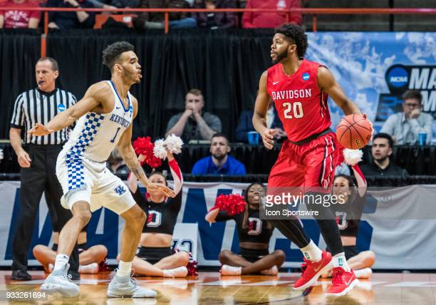 KiShawn Pritchett of the Davidson Wildcats moves the ball around the perimeter with F Sacha KilleyaJones of the Kentucky Wildcats guarding during the...