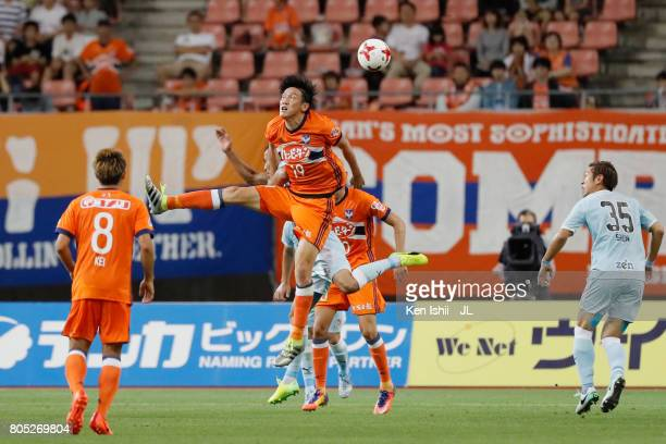 Kisho Yano of Albirex Niigata and Fozil Musaev of Jubilo Iwata compete for the ball during the JLeague J1 match between Albirex Niigata and Jubilo...
