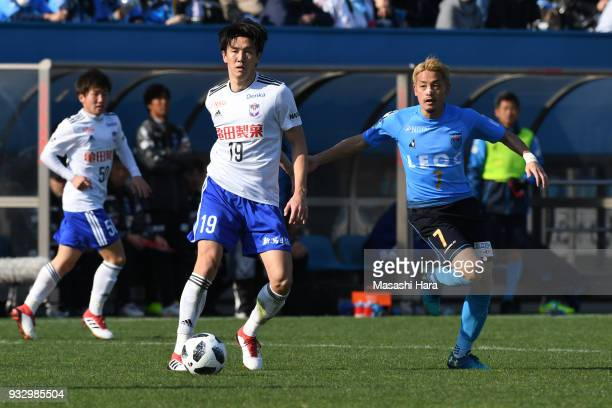 Kisho Yano of Albirex Niigata and Naoki Nomura of Yokohama FC compete for the ball during the JLeague J2 match between Yokohama FC and Albirex...