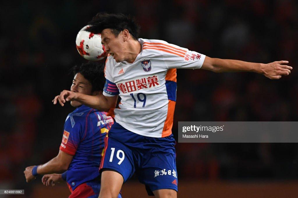 Kisho Yano of Albirex Niigata and Ryoya Ogawa of FC Tokyo compete for the ball during the J.League J1 match between FC Tokyo and Albirex Niigata at Ajinomoto Stadium on July 30, 2017 in Chofu, Tokyo, Japan.