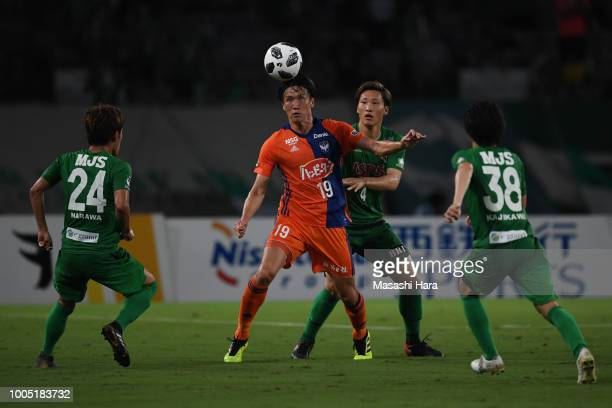 Kisho Yano of Albirex Niigata and Shinnosuke Hatanaka of Tokyo Verdy compete for the ball during the JLeague J2 match between Tokyo Verdy and Albirex...