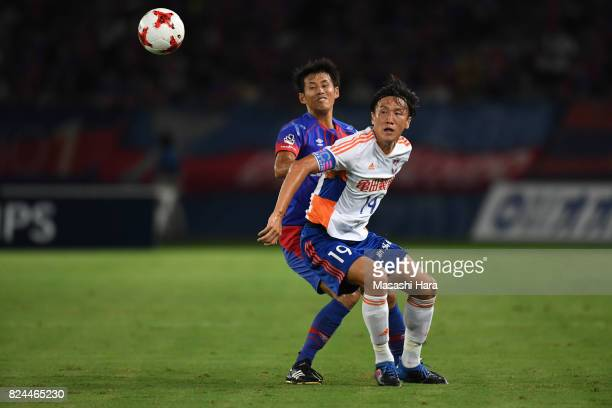 Kisho Yano of Albirex Niigata and Takuji Yonemoto of FC Tokyo compete for the ball during the JLeague J1 match between FC Tokyo and Albirex Niigata...