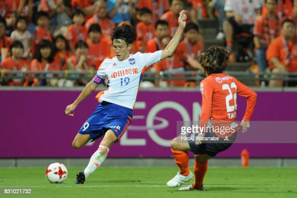Kisho Yano of Albirex Niigata and Takuya Wada of Omiya Ardija compete for the ball during the JLeague J1 match between Omiya Ardija and Albirex...