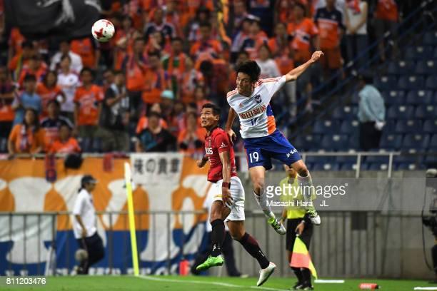 Kisho Yano of Albirex Niigata and Tomoaki Makino of Urawa Red Diamonds during the JLeague J1 match between Urawa Red Diamonds and Albirex Niigata at...