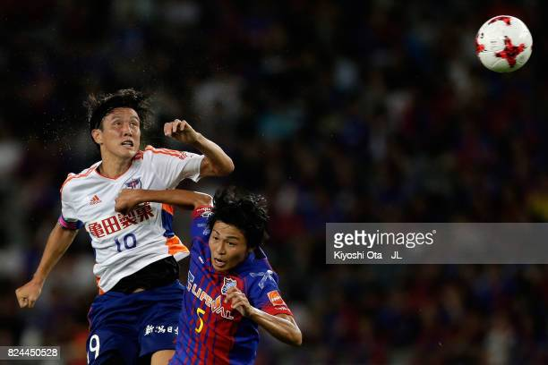 Kisho Yano of Albirex Niigata and Yuichi Maruyama of FC Tokyo compete for the ball during the JLeague J1 match between FC Tokyo and Albirex Niigata...