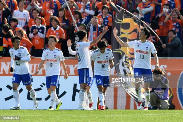Kisho Yano of Albirex Niigata celebrates scoring his side's second goal during the JLeague J2 match between Yokohama FC and Albirex Niigata at...
