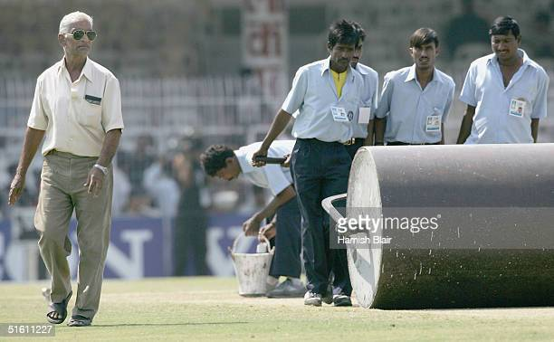 Kishor Pradhan curator of the pitch oversees the rollers in the break in innnings during day four of the Third Test between India and Australia...