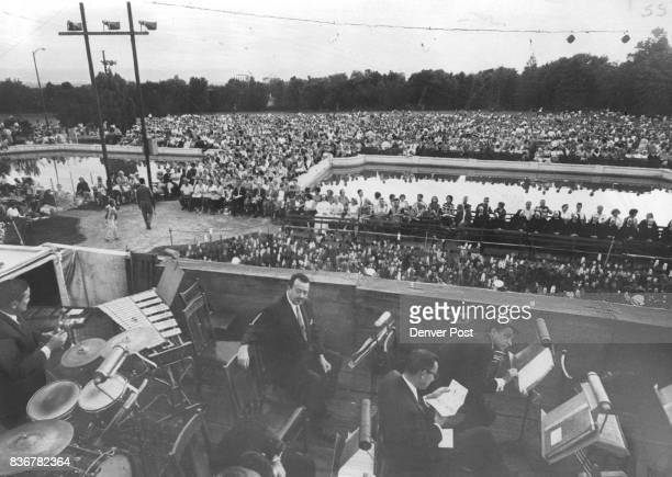 Kismet' EntertainsExcept When Duty Calls Seated in front of the stage at Denver's Cheesman Park photo above is a portion of the crowd estimated at...