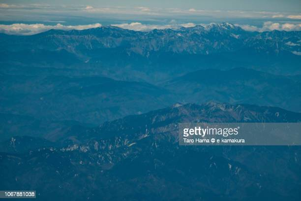 Kiso Mountains (Central Alps) and Hida Mountains (Northern Alps) in Japan daytime aerial view from airplane