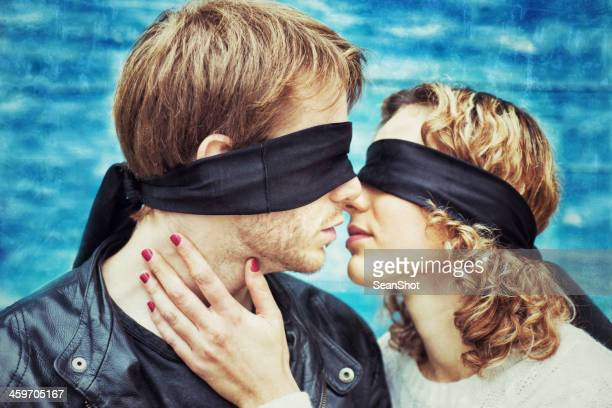 kiss. blindfolded young couple is kissing - love is blind stock pictures, royalty-free photos & images