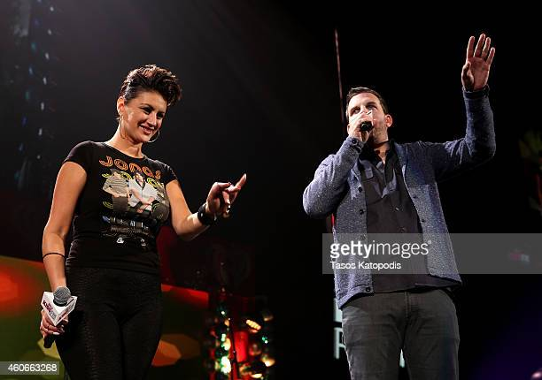 Kiss FM personalities Angi Taylor and Christopher Frederick speak onstage during 1035 KISS FM's Jingle Ball 2014 at Allstate Arena on December 18...