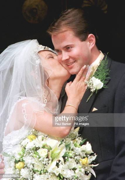 A kiss for new husband Stuart Fergus from new wife Denise Bulger at St Chad's Church Kirkby Liverpool today See PA story SOCIAL Bulger Photo by Paul...