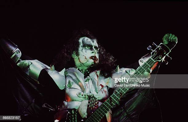 Kiss Gene Simmons goggling and vomiting blood on stage in USA, unknown, July 1976.