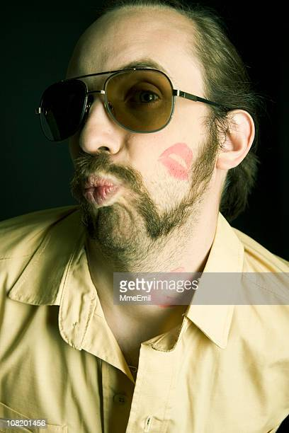 kiss me baby! - gigolo stock photos and pictures