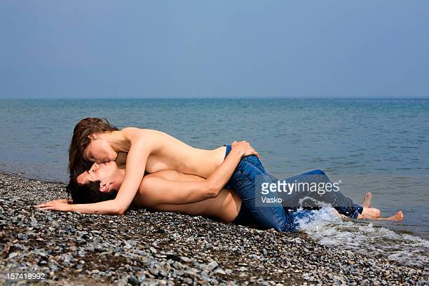 kiss on the beach - sex symbol stock pictures, royalty-free photos & images