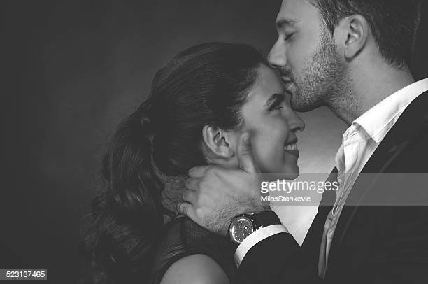 kiss on the forehead - 20 29 years stock pictures, royalty-free photos & images