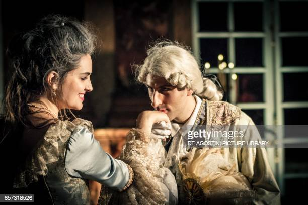 A kiss on the hand courtship party with participants wearing clothes from the Louis XIV period Palace of Versailles France Historical reenactment