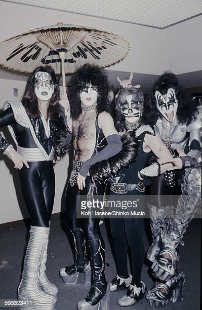 Kiss photo session holding coarse oilpaper umbrellas in a hotel Tokyo March 1977