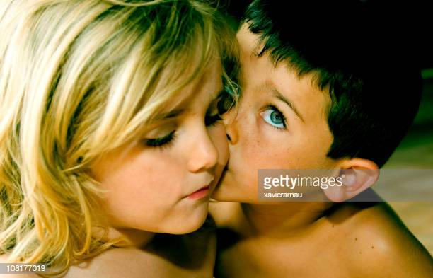 kiss - girls kissing stock photos and pictures