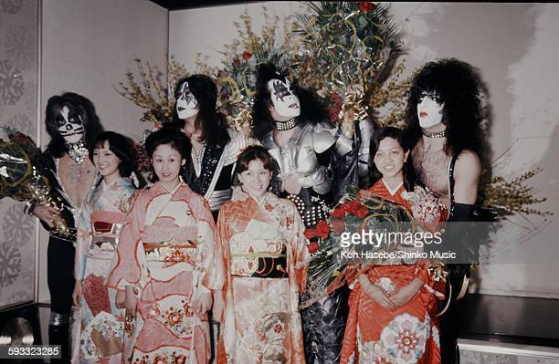 Kiss presented flowers by women in kimono at welcome reception, Tokyo, March 1977.