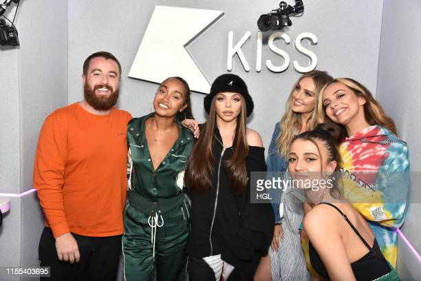 Kiss presenters Tom Green and Daisy Maskell pose with LeighAnne Pinnock Jesy Nelson Perrie Edwards and Jade Thirlwall of Little Mix during a visit at...